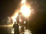 A fire fighter faces the flames at the O'Leary home in Franklin during the May 2010 flood