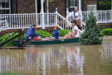 A family leaves their home by canoe during the May 2010 flood in Bellevue